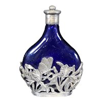 Azure Blue Perfume Bottle Enclosed in Metal Decorative Casing