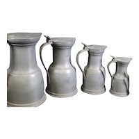 Pewter set of 5 Italian Measuring Jugs with Lids & Acorns