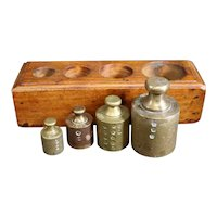 Set of Four Apothecary or Vendor Brass Weights in Wooden Block