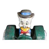 Porky Pig Riding a Cast Iron Tractor