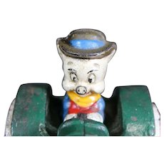 Porky Pig Riding a Cast Iron Tractor