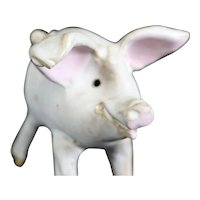 A Smiling Standing Ceramic Pig with Outsized Ears