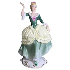 Royal Dux Porcelain Figure of Girl Holding Flower