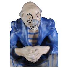 Sad Blue Clown Sitting on a Stool