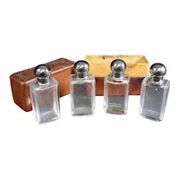 Four Perfume Bottles with Stoppers in Leather Case