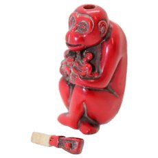 Carved Miniature Red Perfume or Snuff Bottle of Sitting Monkey