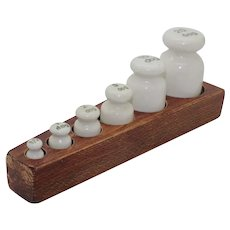 Set of Rare Six Porcelain Weights in Oak Stand