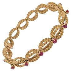 Boucheron 18 Karat Yellow Gold Woven Rope & Ruby Bracelet