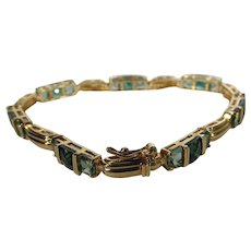 Swarovski Tennis Bracelet in Gold Tone (sterling) with Green Crystals