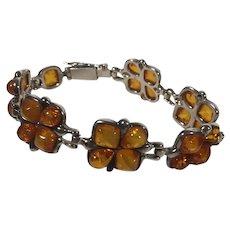 Sterling Bracelet with Honey Amber Links in Floral Design
