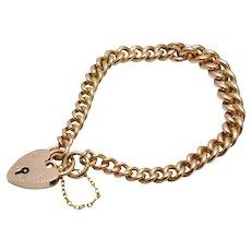9k Gold Curb Link Bracelet With Heart Padlock
