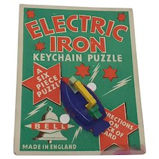 Bell Plastic keychain Puzzle Electric Iron Carded