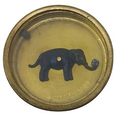 C19th round brass hoffmann dexterity puzzle Elephant