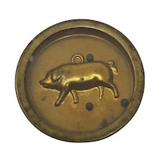 C19th round brass hoffmann dexterity puzzle Pig