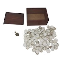 Antique box of  pottery gaming counters and Put and Take spinning top