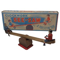 1950's Prestyn tin-plate clockwork See-Saw toy Boxed