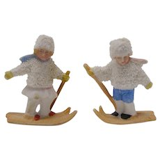 Two vintage bisque snow baby cake decorations Girl and Boy Skiing