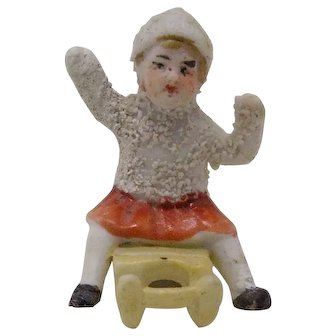 vintage bisque snow baby Girl on Sled cake decoration