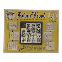 1950's Fairylite plastic tile slide puzzle Robin Hood carded
