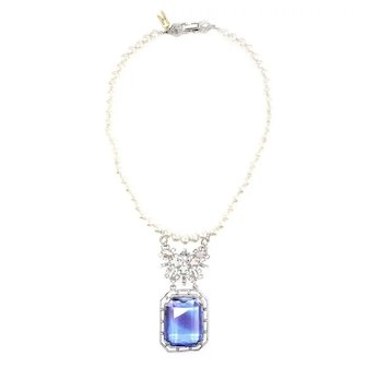 Gorgeous blue sapphire drop pendant on knotted imitation pearl necklace
