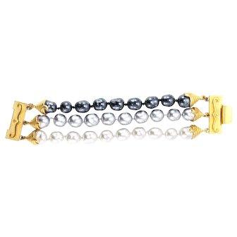 CAROLINA HERRERA 3-row bracelet of black, grey & lt. grey  imitation baroque pearls