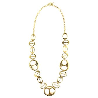 """(signed Restated by Trudelle Laker) Gold plated necklace comprised of """"Gucci"""" style symbols"""