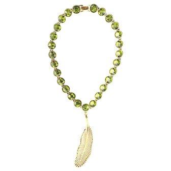 "(signed)Restated by Trudelle Laker gold plated ""feather"" pendant on Swarovski olivine bezel stone set necklace"