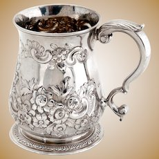 George II Sterling Silver Christening Mug with a Chased Floral and Scroll Baluster Form Body