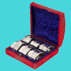 Six Boxed Antique Aesthetic Movement Silver Plated Napkin Rings