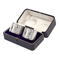 Pair of Boxed Edwardian Sterling Silver Napkin Rings with a Floral and Scroll Pattern