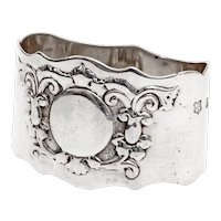 Edwardian Oval Silver Napkin Ring Embossed with Scrolls and Flowers