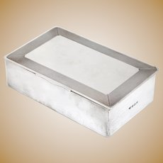 Sterling Silver Cigar or Cigarette Box with a Hinged Lid and Engine Turned Border with a Plain Panel