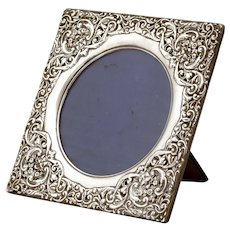 Edwardian Sterling Silver Picture Frame with a Border Decorated with Repousse Classical Faces