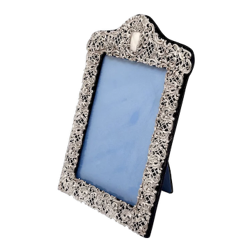 Edwardian Silver Photo Frame with a Pierced and Embossed Flower Scrolls Border