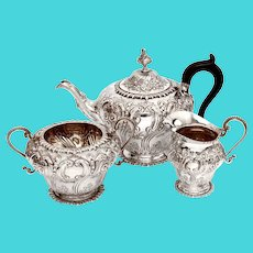 Late Victorian Three Piece Sterling Silver Tea Set Chased with Flowers and Scrolls