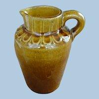 Brown glaze stoneware pitcher
