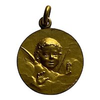 Antique  French Cherub Angel Pendant Charm bronze with gold on it