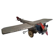 Vintage Prewar Girard Tin wind-up World Tours airplane