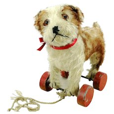 Steiff Molly dog puppy on eccentric wooden wheels, prewar ff button, red label, 1927 – 42 made