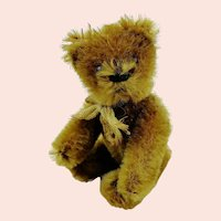 1920s Schuco miniature teddy bear, jointed, cinnamon mohair covered metal corpus
