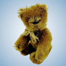 1920s Schuco miniature teddy bear, jointed, cinnamon mohair covered metal corpus