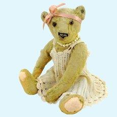 "Antique Steiff teddy bear with prewar ff button, 10"" well-loved, restored"