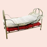 "Antique metal doll crib, original bedding, 1910s made, 12"" long"