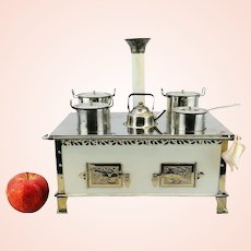 """Marklin Doll Stove, complete with original dishes, 12"""" wide"""