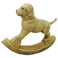 "Squeak dog in the shape of a dog rocker, 1930s, 8"", squeaker lost"