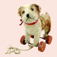 Steiff Molly dog puppy with ff button, red label, eccentric wheels, 1927 to 42