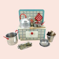 Dollhouse kitchen stove with makers mark and dishes, US Zone Germany, 1947 to 1953