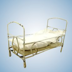 """White metal dollhouse doll crib, 1910s German made with bedding, 6 by 3"""""""
