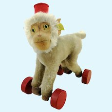 Steiff baboon Coco on wheels, with IDs, first ever edition, 1951 to 1958, excellent