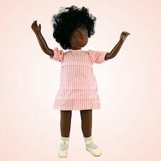Sasha doll 'Black girl Cora', 1970s made in England by Trendon Ltd., original dress